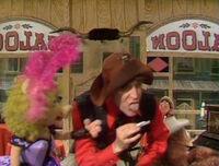 Wally Boag rolls a cigarette