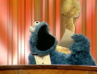 Cookie eats award envelope - Monster Hits