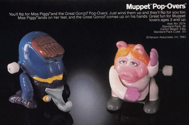 File:Tomy 1983 catalog muppet pop overs wind-up gonzo piggy.jpg