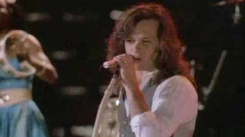 "John Mellencamp - ""I Saw Mommy Kissing Santa Claus"""