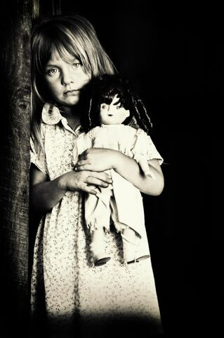 File:Ist2 8883747-portrait-of-little-girl-holding-doll-black-and-white.jpg