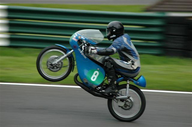 File:Motorcycle wheelie.jpg