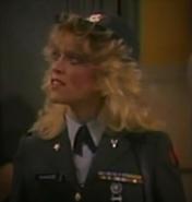 Judy Landers as MAJ Savage