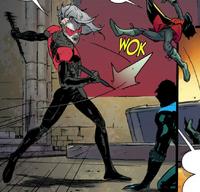 Nightwing 17 (2016) - Deathwing knocks Damian away