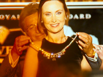 File:Bank adorns wife with diamonds.png