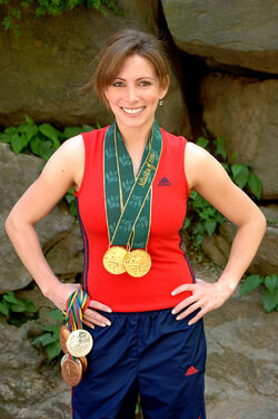 Shannon Miller with medals in gym outfit