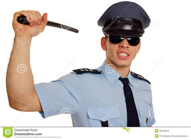File:Angry-policeman-police-baton-shows-you-35364924.jpg