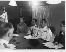 Japanese officers discussing surrender of Penang on board HMS Nelson