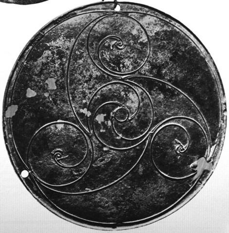 File:Celtic triskele of three stylized bird heads with whorl in the center.jpg