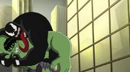 Venom taking Hulk down