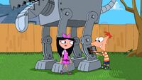 Isabella walks up to Phineas working on the robot dog.jpg