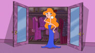Candace tries on a blue gown