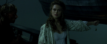 Elizabeth drops the medallion