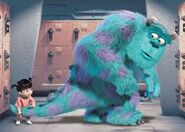 Boo holding Sulley's tail