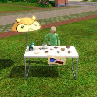 Chłopiec sprzedający swoje wypieki