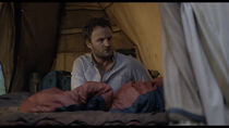 Malcolm wakes Ellie