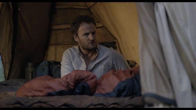 File:Malcolm wakes Ellie.jpg