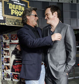Kurt Russell smiles with director Quentin Tarantino