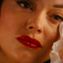 Wiping her tears.