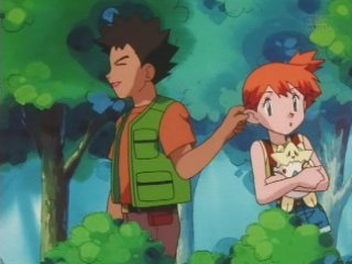 File:Brock pulling Misty by the ear again.jpg