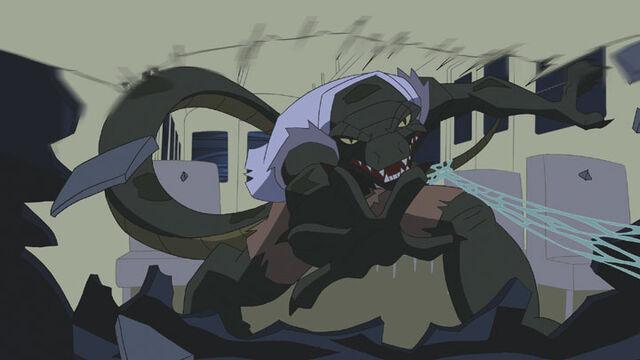 File:Lizard-tearing522.jpg