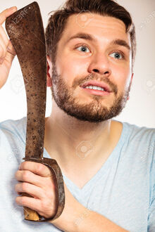 49096964-Young-man-with-shaving-having-fun-with-machete-large-knife-Handsome-guy-removing-face-beard-hair-Ski-Stock-Photo