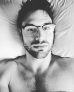 Ryan Guzman with glasses