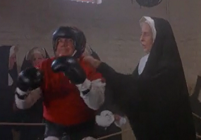 File:Sister Sarah fits Father Mulrooney's mouthpiece.png