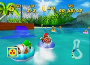Diddy Kong and allies racing in Whale Bay