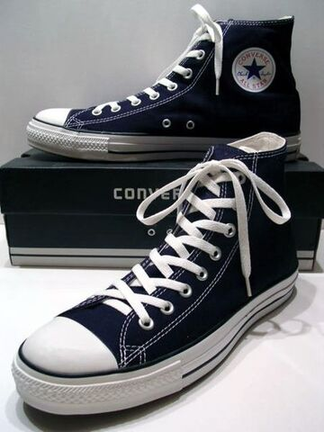 File:A classic Black pair of Converse All Stars resting on the Black & White Ed Shoebox (1998-2002).jpg