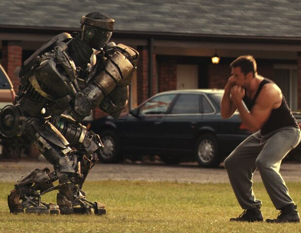 File:Hugh-Jackman-with-star-robot-Atom-in-Real-Steel.jpg