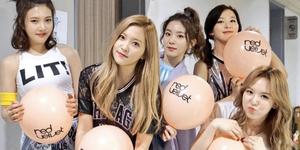 RV holding Red Velvet balloons