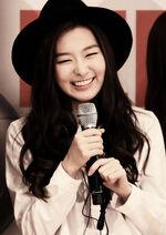 Seulgi holding a microphone