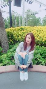 Irene next to flowers