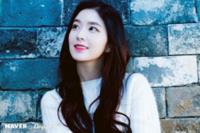 Irene by a brick wall