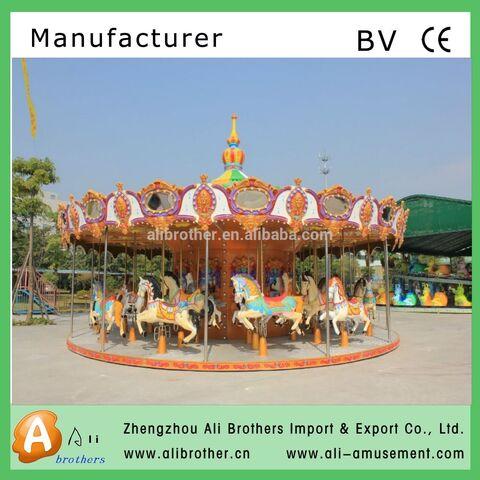 File:Musical carousel outdoor playground Amusement musical kids.jpg