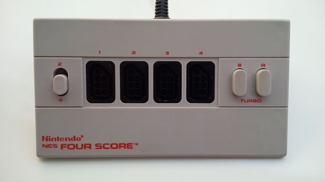 File:Nintendo Entertainment System Four Score multiplayer adapter top.jpg