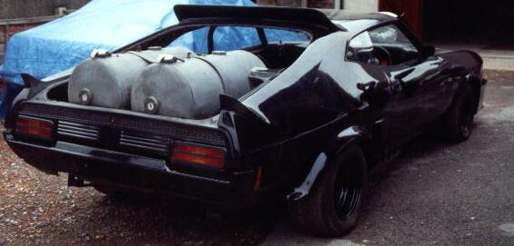 File:Mad-max-interceptor-delivered-to-cars-of-the-stars-rear.jpg