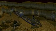 Ana in a barrel in a mine cart