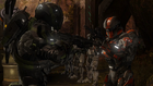 Locus and Felix hold each other at gunpoint