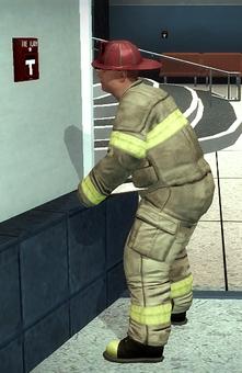 Fireman - red helmet - performing inspection