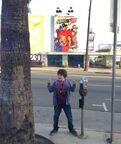 Cameron under the Sam and Cat billboard