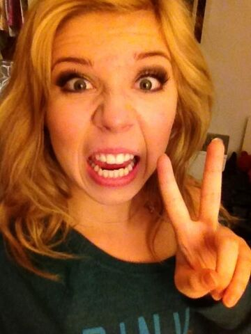 File:Jennette showing the peace sign.jpg