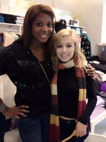 File:Jennette with a fan in a clothing store.jpg