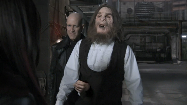 File:0x04 Druitt with his fist through Bigfoot.png