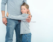 Child hugging adult