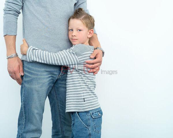 File:Child hugging adult.jpg