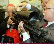Cardinal with gun