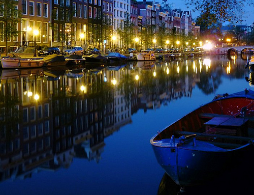 Blue canal at night in Amsterdam