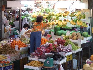 Fruit-seller in the Tekka market